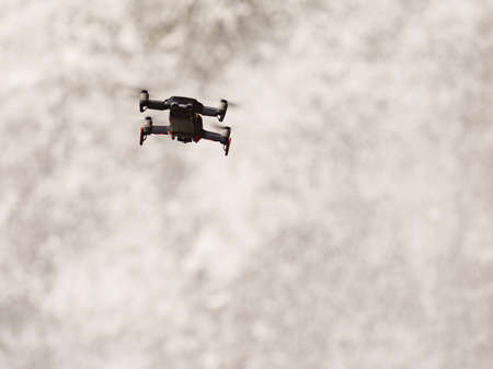Drone flying against river waterfall, take photo and video