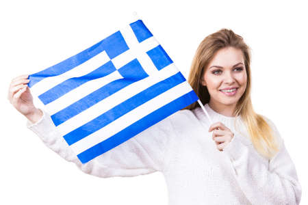 Happy funny woman holding Greece greek national flag being patriotic loving her country.