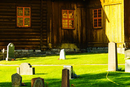 LOM, NORWAY - JULY 7, 2018: Graveyard with old tombstones around Lom Stave Church in Oppland county, Norway.