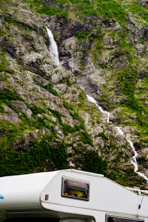 Camper car motorhome with alcove on roadside in mountains. Camping on trip. Norway Scandinavia Europe.