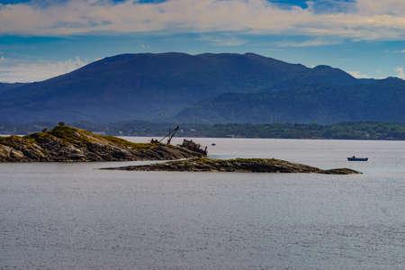Norwegian coastline with fishing boats. View from Atlantic road national route Atlanterhavsvegen, Norway Europe. Travel holidays.