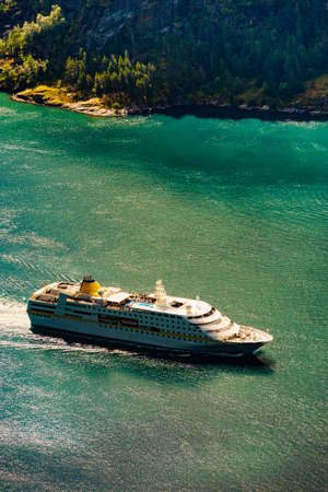 Fjord Geirangerfjord with big cruise ship. Travel and holidays