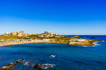 Mediterranean Sea coast landscape, spanish coastline in Murcia region. Tourist site. Cala Reona in Cabo de Palos.