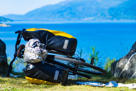 Mountain bicycle with attached bag saddlebag against nature, mountains fjord landscape in Norway