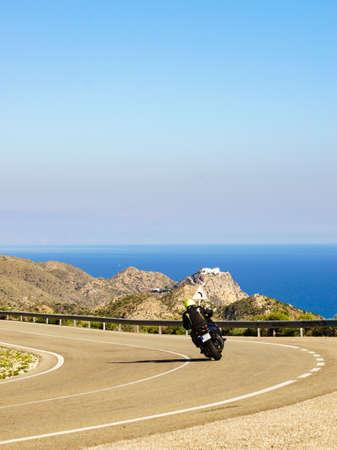 Spanish coast landscape with motorcycle on road. Granatilla Carboneras viewpoint, Cabo de Gata Park, provincia Almeria, Spain.