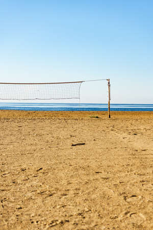Volleyball summer sport equipment. Net netting wire on sandy beach outdoor. Active lifestyle.
