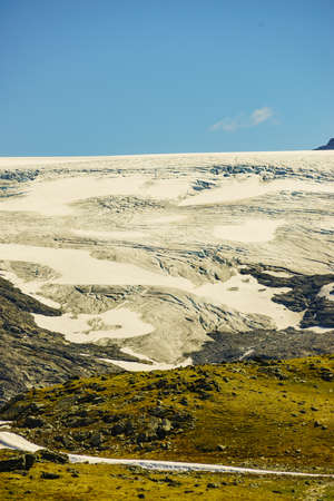 Mountain landscape in summertime with snowy peaks and glaciers. National tourist scenic route 55 Sognefjellet between Lom and Gaupne, Norway.