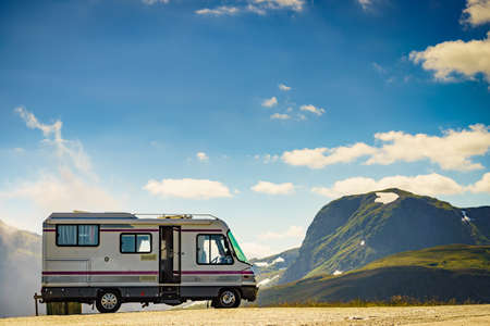 Camper car on roadside in norwegian mountains. Traveling, holidays and adventure concept. Norway Scandinavia Europe.