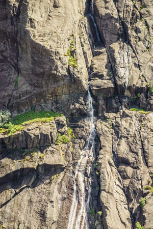 Tourism holidays and travel. Waterfall in norwegian mountains Norway Scandinavia.