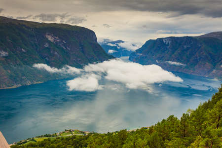 Aurlandsfjord fjord landscape with clouds over sea surface. Norway Scandinavia. National tourist route Aurlandsfjellet.