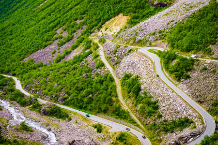 Trolls Path Trollstigen winding scenic mountain road with cars, Norway Europe. National tourist route.
