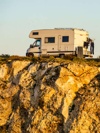 Camper vehicle wild camping on cliff rock, Cabo de Gata Nijar Natural Park in Almeria province, Andalusia Spain.