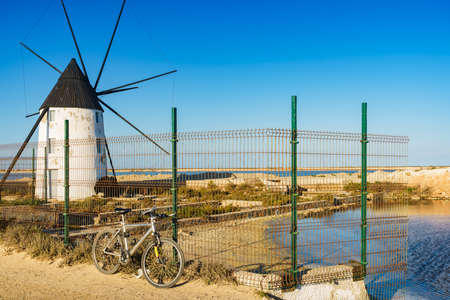 Old historic windmill in salt marshes at San Pedro del Pinatar park, Murcia Spain. Tourist attraction