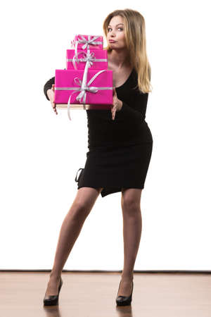 People celebrating xmas love and happiness concept. Elegant blonde girl holding presents stack of pink gift boxes, on white