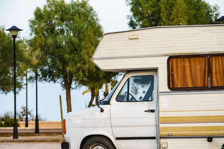 Camping on sea shore. Camper vehicle on beach, mediterranean coast in Spain. 版權商用圖片