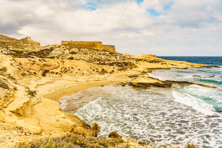 Castle San Ramon above beach of El Playazo, Cabo de Gata Nijar, province Almer