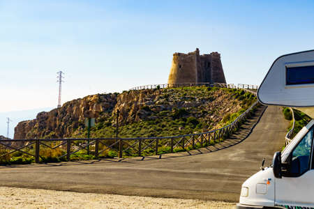 Rv caravan at Mesa Roldan tower. Visiting Cabo de Gata Nijar Natural Park in Almeria province, Andalusia Spain. Tourist attraction, Defense towers. 新聞圖片