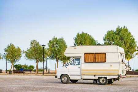 Camping on sea shore. Camper vehicle on beach, mediterranean coast in Spain. 스톡 콘텐츠