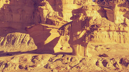 The Enchanted City of Bolnuevo, yellow sandstone shapes, rock formations, Murcia Spain. Tourist attraction.