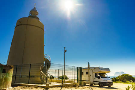 Caravan on mediterranean coast at lighthouse Carbonera, La Alcaidesa, Spain. Vacation and traveling in mobile home.