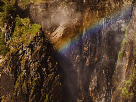 Rainbow in in rocky mountains in summer, Mabodalen valley Norway. National tourist Hardangervidda route.