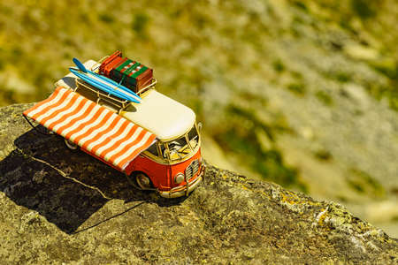 SOGNEFJELLET, NORWAY - JULY 7, 2018: Miniature scale model hippy VW van in norwegian mountains, tourist route Sognefjellet, the highest mountain road in Northern Europe