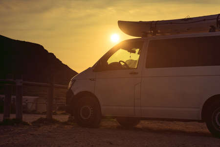 Active lifestyle sport concept. Car van with canoe on top roof on Monsul parking, Cabo de Gata Nijar Natural Park, province Almeria, Andalusia, Spain.