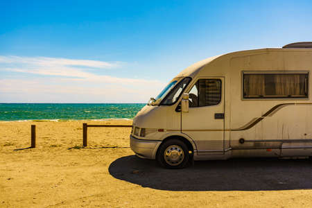 Camper car on Quitapellejos Beach, Andalucia region in Spain. Traveling and adventure in motor home. Summer holidays