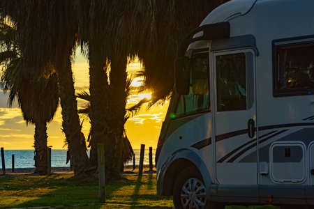 Camper rv at sunset on mediterranean coast Spain. Camping on nature beach. Costa tropical, province Granada, Andalucia Spain. Standard-Bild