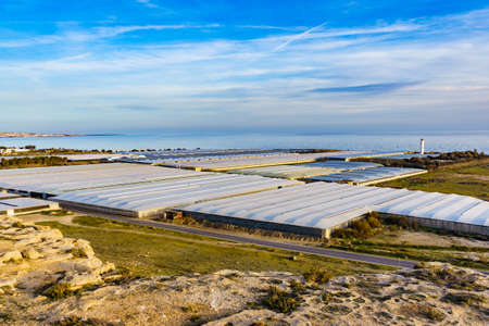 Spanish landscape and view of sea coast with many plastic greenhouses. Almeria region, Andalusia Spain. Stock Photo