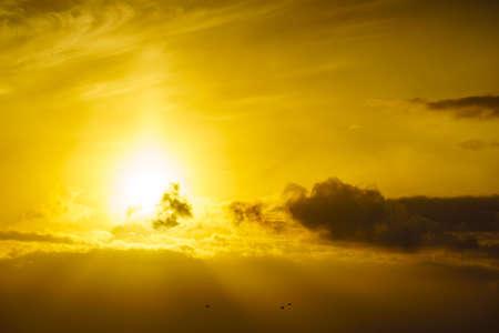 Sunrise over sea. Bright sun under the water surface. Sun up above horizon. Morning seascape.