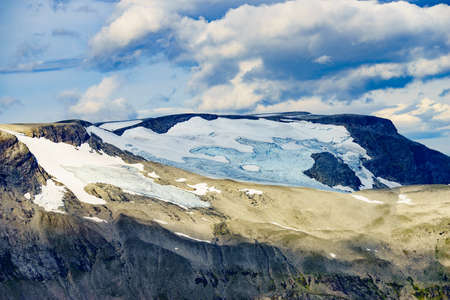Snowy mountain tops with glacier, view from Dalsnibba viewpoint in Norway. Mountains landscape.