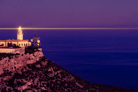 Mesa Roldan lighthouse at evening, Cabo de Gata Nijar Natural Park in Almeria province, Andalusia Spain. Tourist attraction, interesting place.