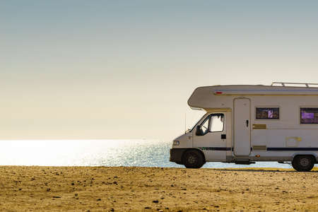 Camper rv caravan on mediterranean coast in Spain. Wild camping on beach. Holidays and travel in motor home. 写真素材