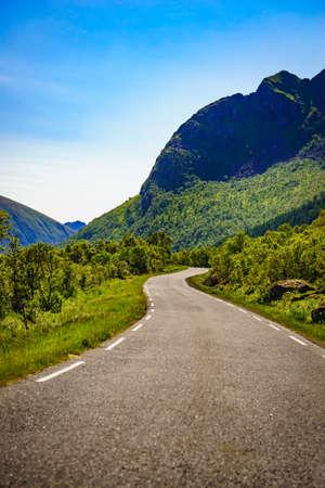 Road through Gimsoya island landscape in Vagan municipality Nordland county, Lofoten archipelago Norway. 写真素材