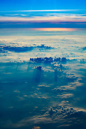View from airplane window to clouds