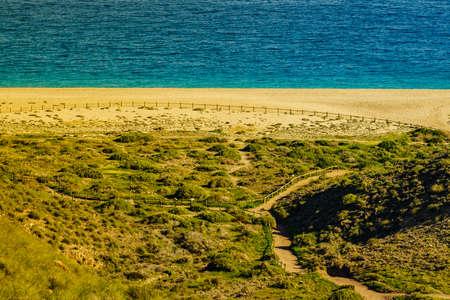 Coastal landscape, walking area path along sandy beach, Cabo de Gata Nijar Natural Park in Spain 写真素材