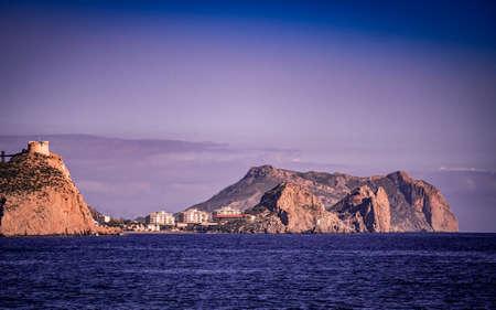 Spanish coastal landscpae with castle San Juan on cliff, Aguilas, Murcia region, Spain. 報道画像