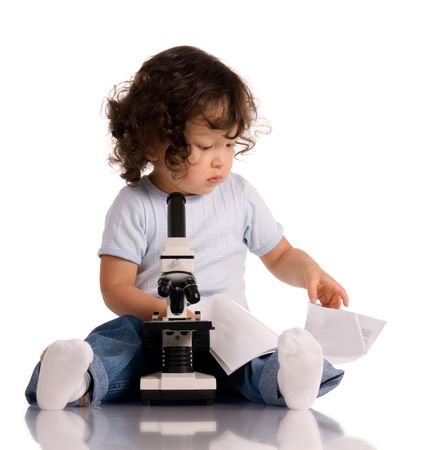 biology instruction: child with microscope, isolated on white