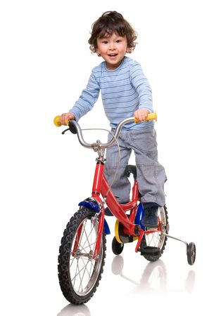 tricycle: lLttle boy riding bicycle Stock Photo