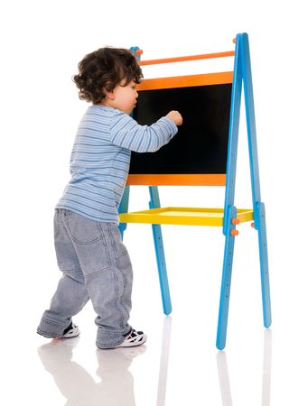 Little boy with chalkboard on white. photo