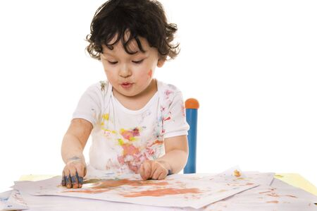 Little boy painting with paints for hands Stock Photo - 5190829