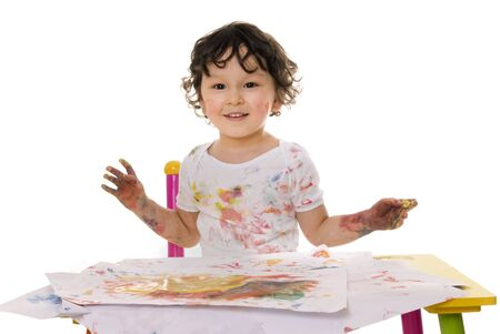 Little boy painting with paints for hands photo