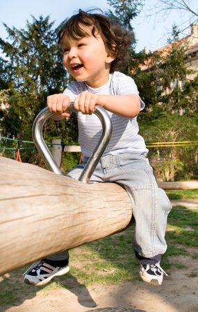 playground children: Ni�o en un patio de juegos. Foto de archivo
