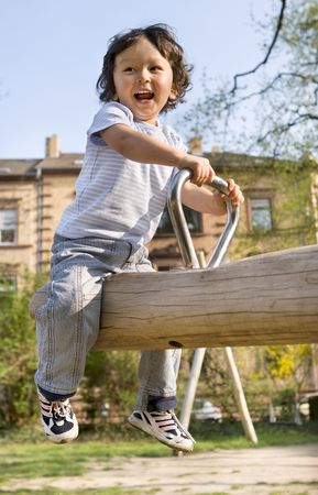 outdoor pursuit: Little boy on a playground.