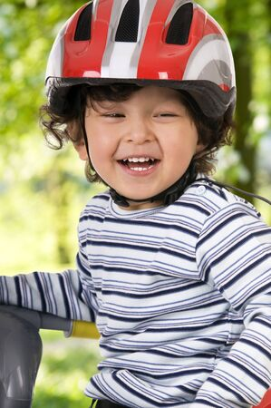 The child in a protective helmet photo