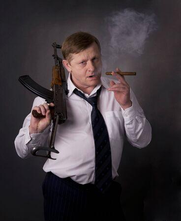 Men with gun and cigar photo