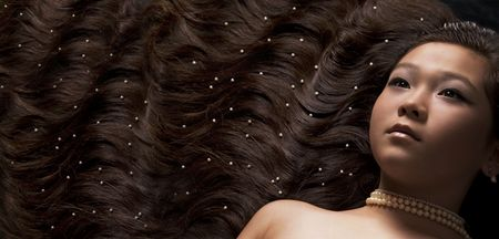 Girl with long hair and pearls photo