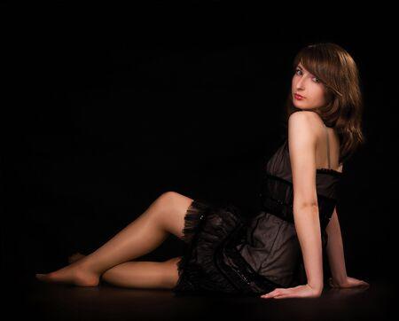 jewelle: beautiful girl sitting on black
