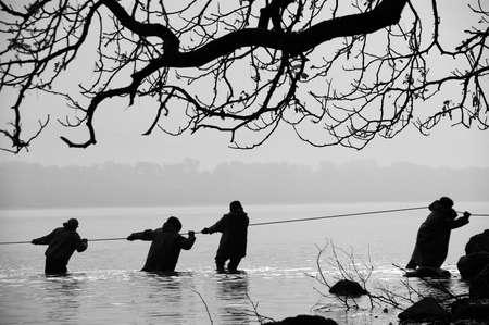 Fishermen in the water photo